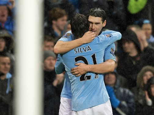 Gareth Barry celebrates his late winner for Man City