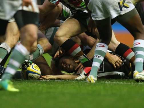 Dany Care forces his way over for a Quins try