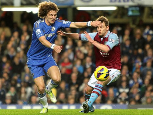 David Luiz and Brett Holman do battle