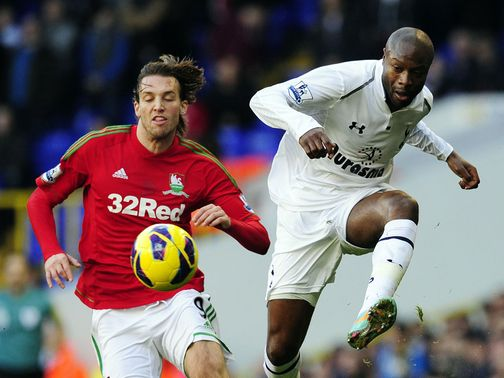 William Gallas plays away as Michu threatens