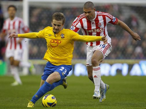 Luke Shaw holds off Jon Walters