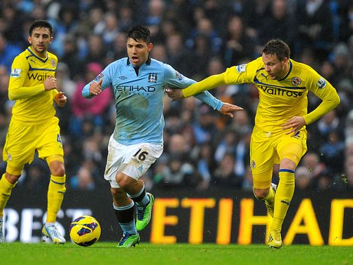 Sergio Aguero and Chris Gunter battle for the ball