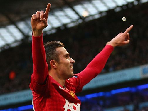 Robin van Persie celebrates his winning goal