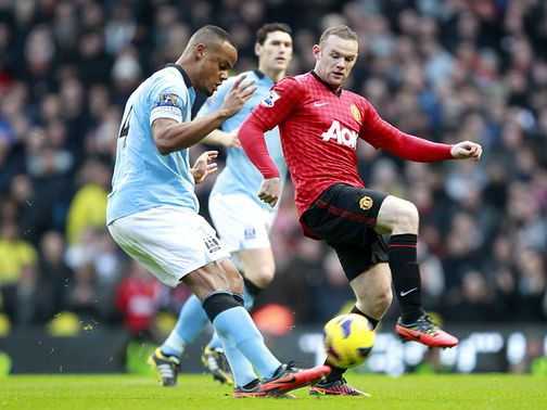 Kompany clears under pressure from Rooney