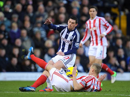 Ryan Shawcross slides in on Graham Dorrans