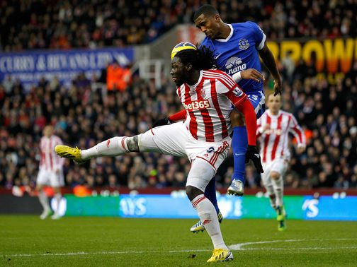 Sylvain Distin does battle with Stoke&#39;s Kenwyne Jones