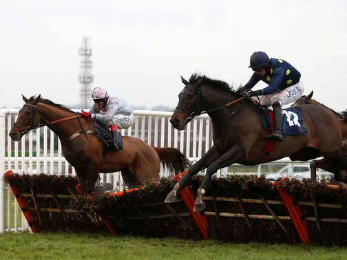 Poet (right) makes a winning start over hurdles