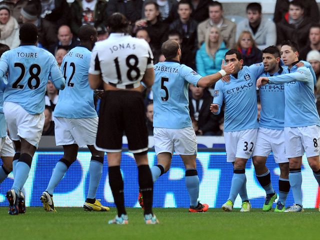 Sergio Aguero celebrates his goal for Man City