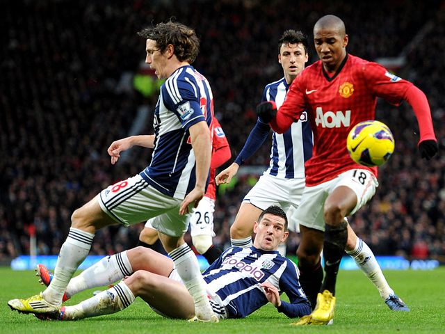 Ashley Young probes for an opening