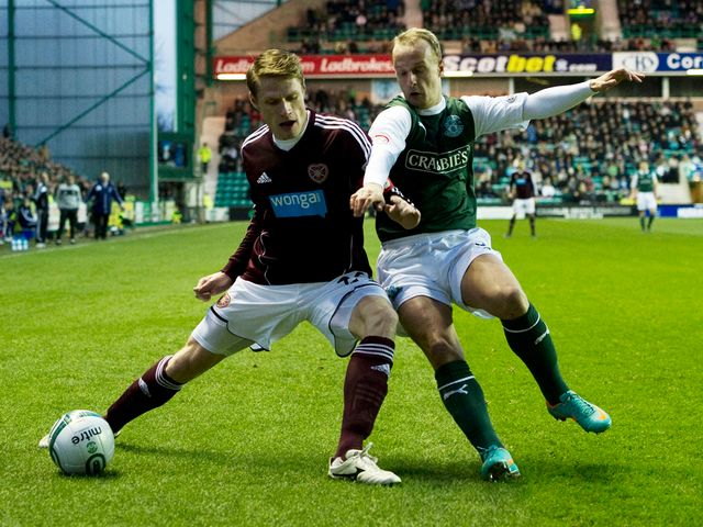 Marius Zaliukas holds off Leigh Griffiths.