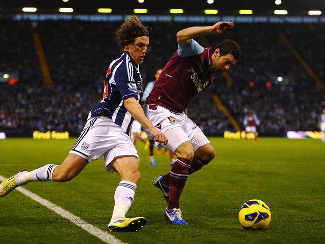 Billy Jones looks to tackle Matt Jarvis.