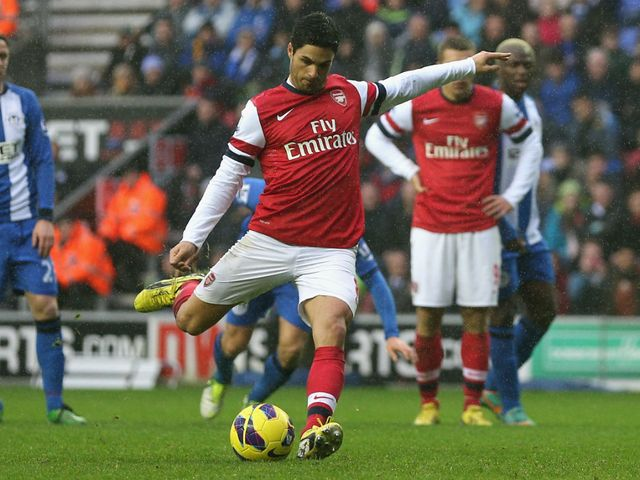 Mikel Arteta slots home the winning penalty