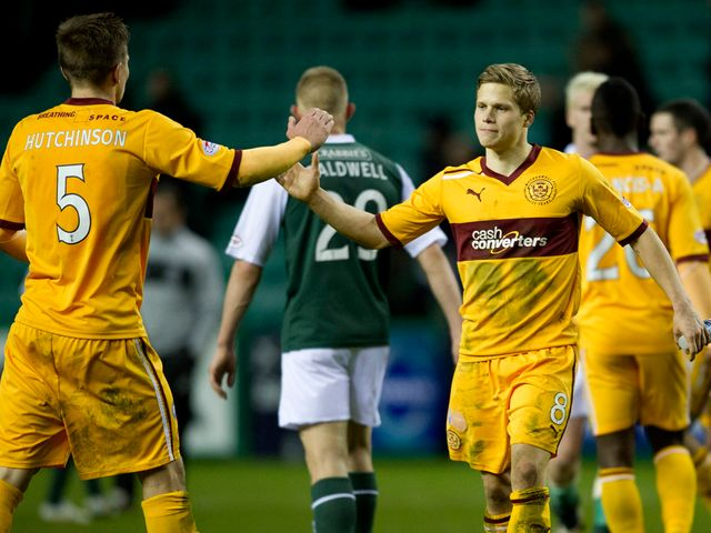 Motherwell celebrate their victory at Hibs