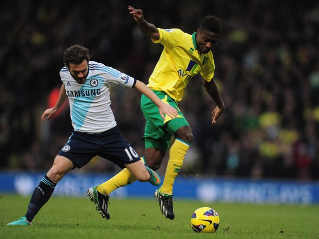 Juan Mata and Alex Tettey battle for the ball