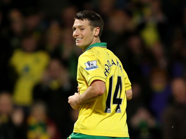 Wes Hoolahan smiles after scoring