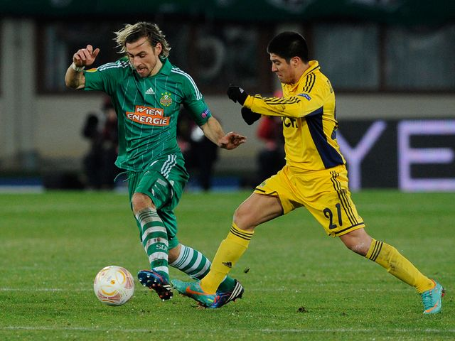 Harald Pichler and Jonathan Cristaldo battle for the ball