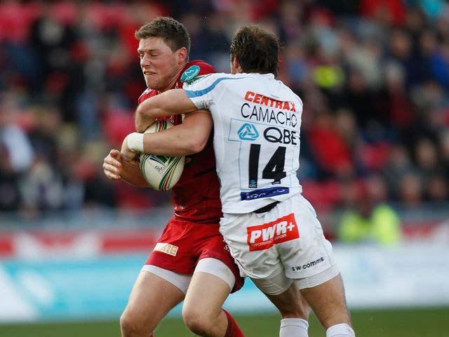 Rhys Priestland is tackled by Gonzalo Camacho