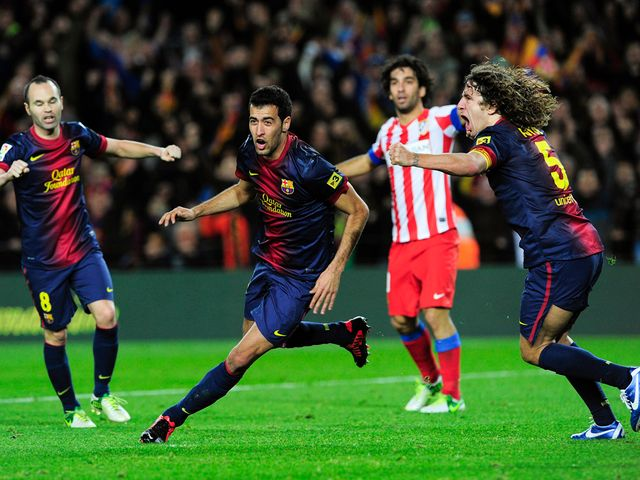 Sergio Busquets celebrates putting Barca ahead
