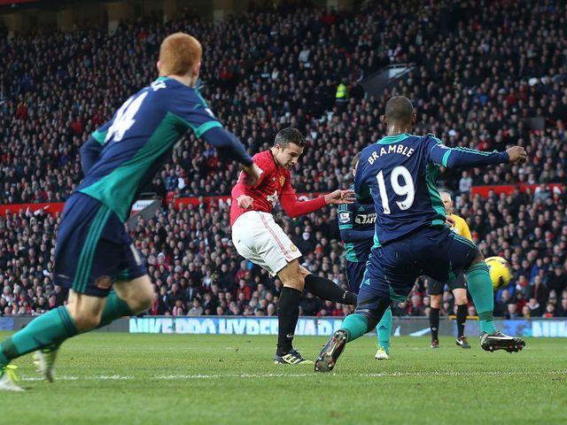 Robin van Persie scores United's opening goal