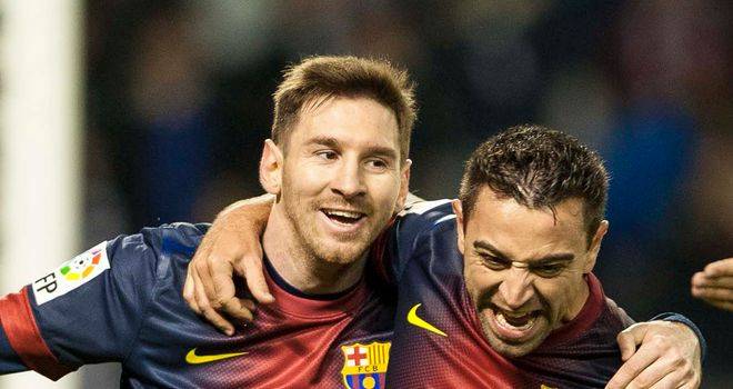 Barcelona joy: Lionel Messi and Xavi scored as the leaders beat Real Valladolid 3-1