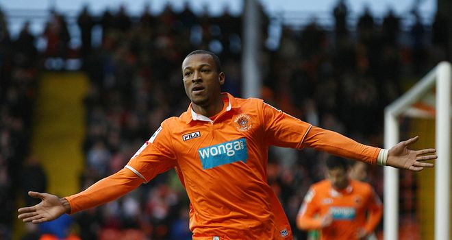 Wes Thomas: Celebrates his opener for Blackpool
