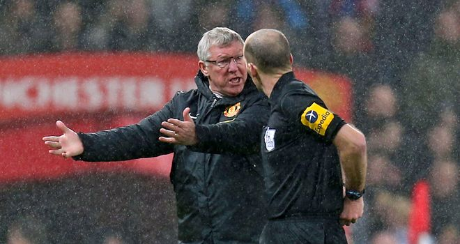 Sir Alex Ferguson confronts Mike Dean at half-time during Manchester United's victory over Newcastle