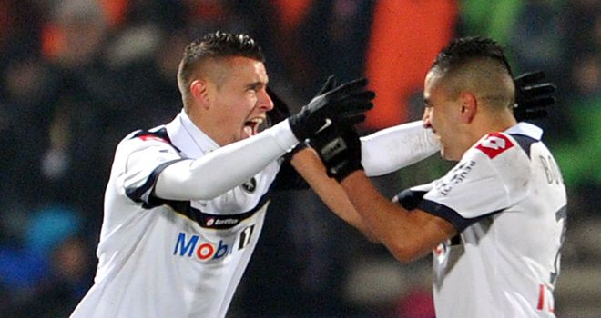 Dias (left) after his late equaliser for Sochaux