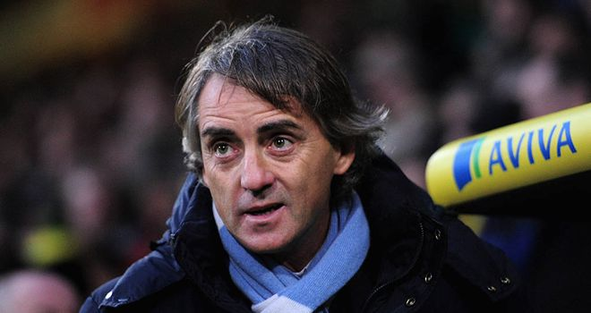 Roberto Mancini: Thinks Man City remain on the title trail