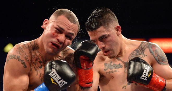 Mike Alvarado (L) takes a right hand from Brandon Rios