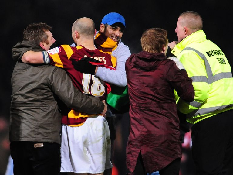 Bradford celebrate their penalties success against Arsenal