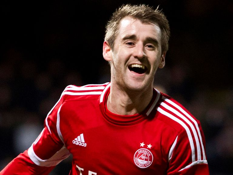 Hat-trick hero Niall McGinn celebrates