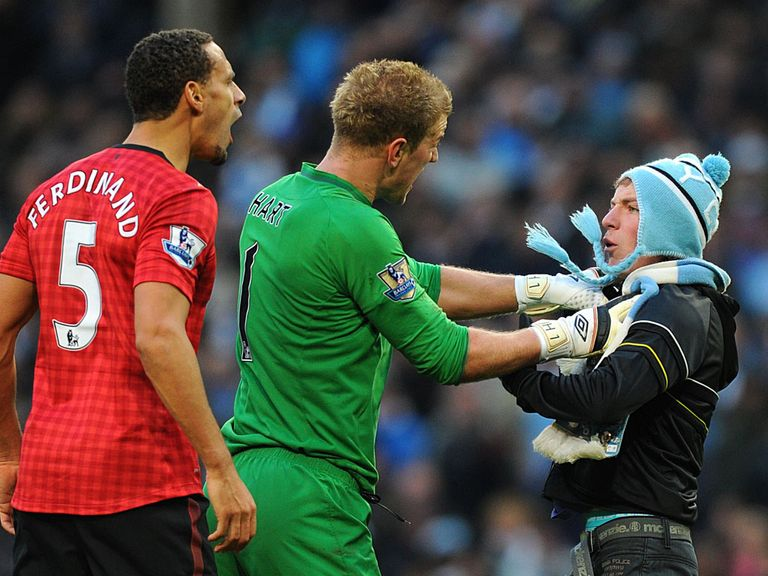 Joe Hart gets between Ferdinand and the fan
