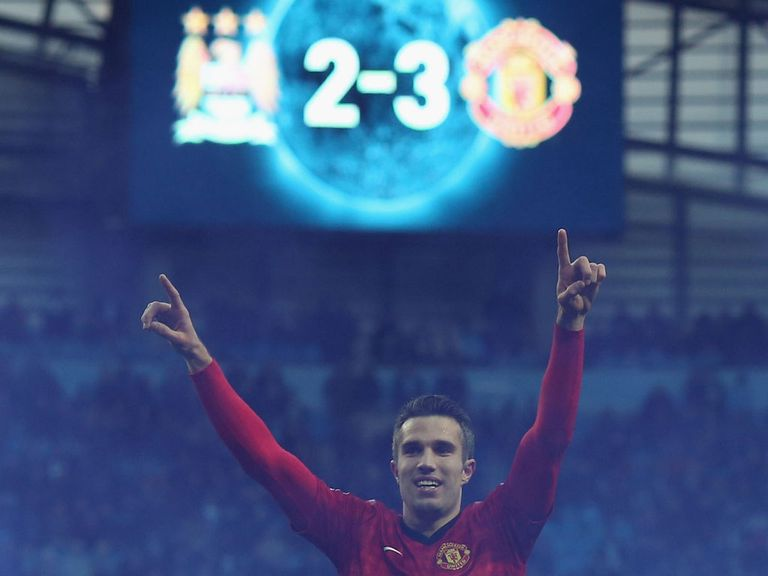 The picture tells the story of Robin van Persie's late Manchester derby winner