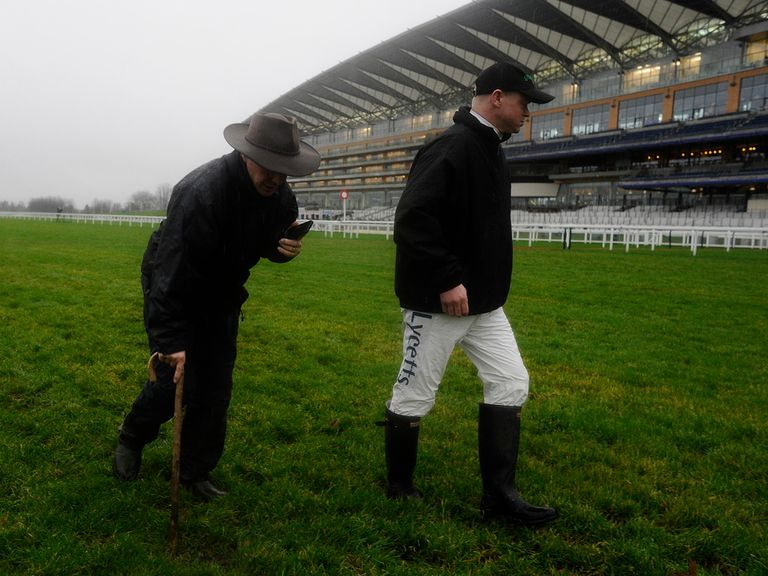 Clerk of the course Chris Stickels walks the track on Saturday