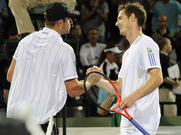 Murray (r) was all smiles despite his defeat to Roddick