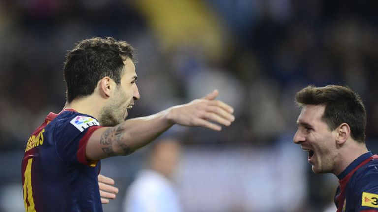 Fabregas and Messi celebrate for Barcelona