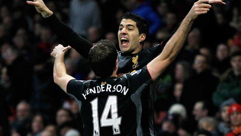 Jordan Henderson celebrates with Luis Suarez