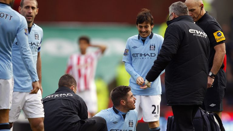 Javi Garcia is treated on the pitch following Glenn Whelan's tackle