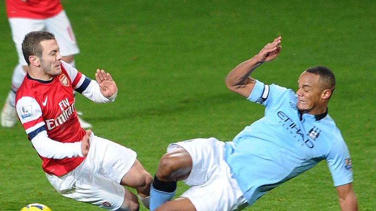 Vincent Kompany: Saw red for this tackle on Jack Wilshere