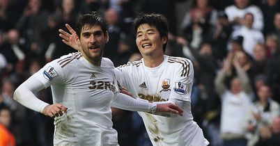 Danny Graham celebrates after his late leveller for Swansea against Arsenal