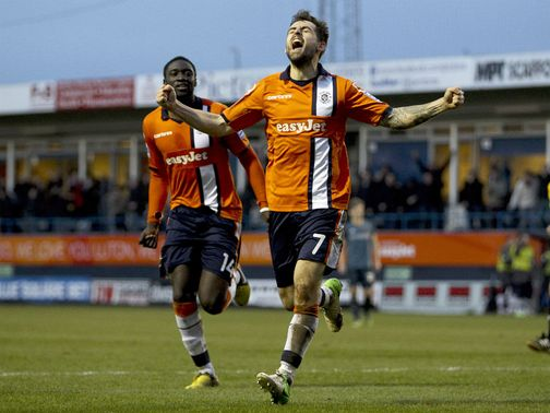 Alex Lawless celebrates the crucial goal