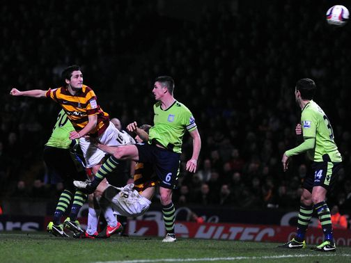 Carl McHugh heads home Bradford&#39;s third goal
