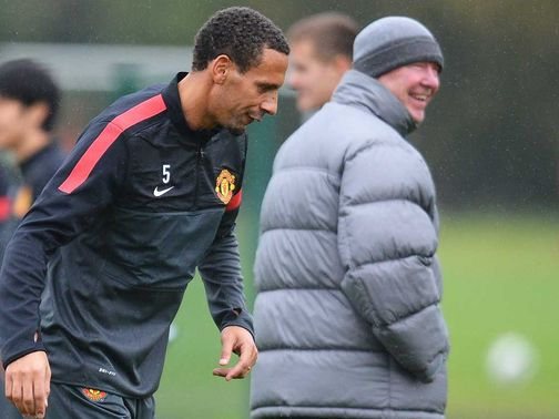 Ferdinand (left) and Ferguson: Boss &#39;not panicking&#39;