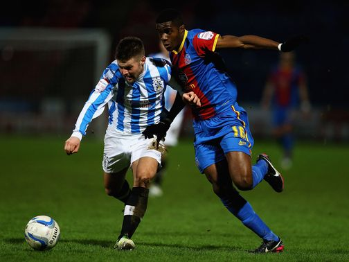 Oliver Norwood and Wilfried Zaha battle for the ball