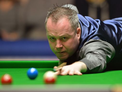 John Higgins: Through despite a slow start