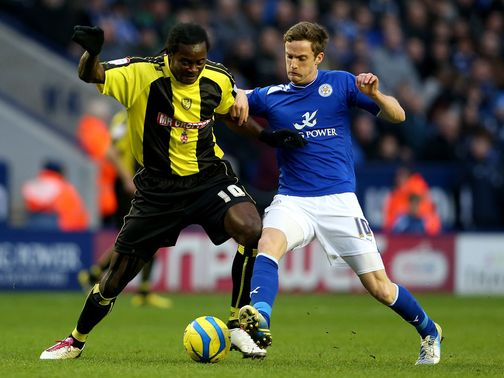 Calvin Zola and Andy King battle for the ball