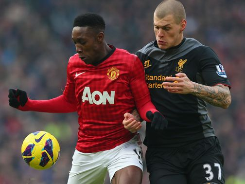 Danny Welbeck holds off Martin Skrtel
