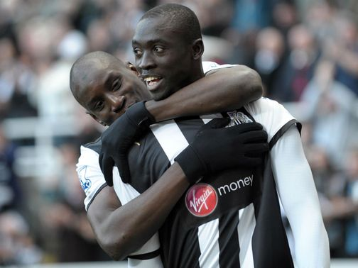 Papiss Cisse (r) takes over the striking role from Ba at Newcastle