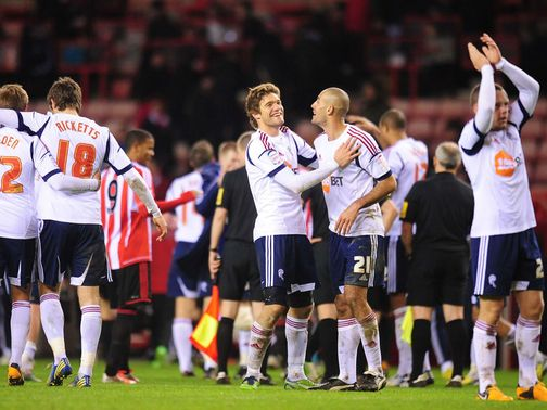 Bolton celebrate their victory at Sunderland