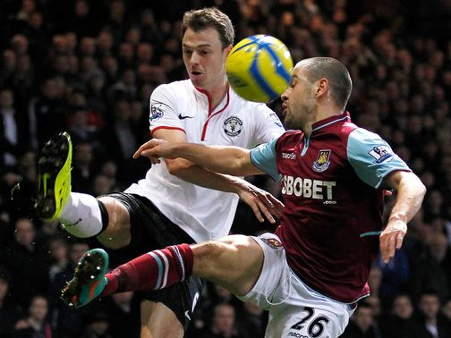 Jonny Evans and Joe Cole battle for the ball